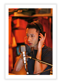 Photo of Cris Law in the studio recording his debut TwinkleU album